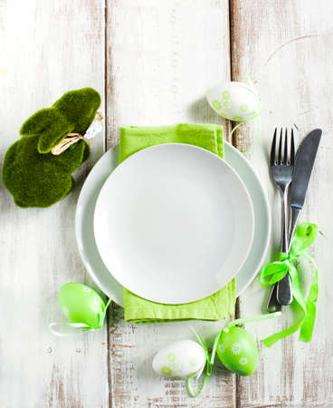 Easter table setting with green bunny decoration Archivio Fotografico