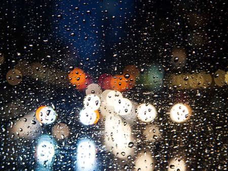 bokeh lights: Night city through windshield. Street Bokeh Lights Out Of Focus. Stock Photo