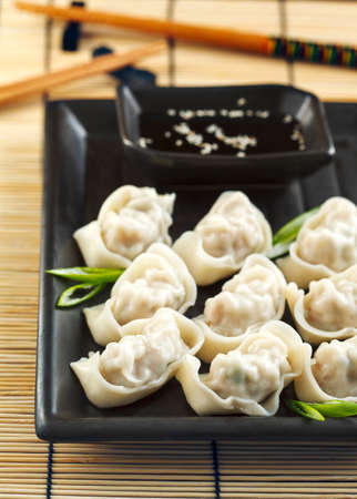 tidbit: Pork and vegetable wonton with soy sauce