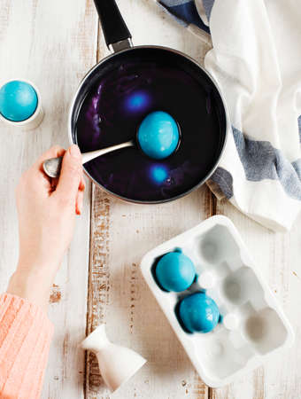 Homemade decoration eggs natural way. Naturally coloring Easter eggs with red cabbage