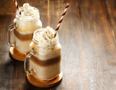 Pumpkin spice latte with whipped cream Stock Photo