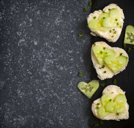 shaped: Cucumber sandwiches in heart shaped, top view Stock Photo