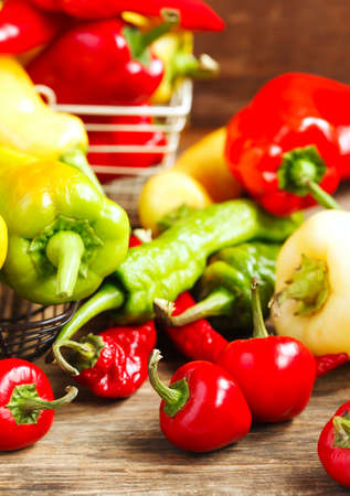 Variety of fresh organic peppers: Cherry hot red peppers, long red and green peppers, sweet banana peppers, sweet cubanelle peppers, sweet red sheppard peppers and hungarian peppers. Stock Photo