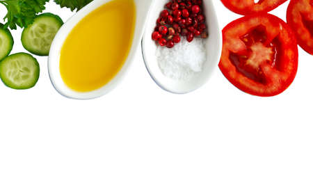 Fresh vegetables, olive oil, herbs and spices isolated on white background with copy space
