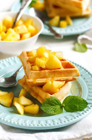 Belgian waffles with caramelized apple and honey Stock Photo