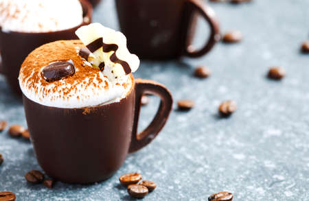 Coffee mousse with whipped cream in chocolate cup