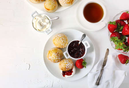 English scones with jam and whipped cream, top view