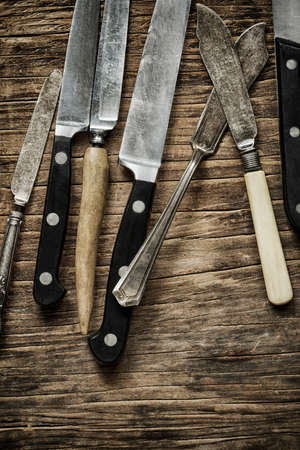 Old knives on wooden background, top view, copy space Stok Fotoğraf