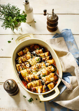 Baked eggplant with tomato sauce and herbs, top view. Reklamní fotografie