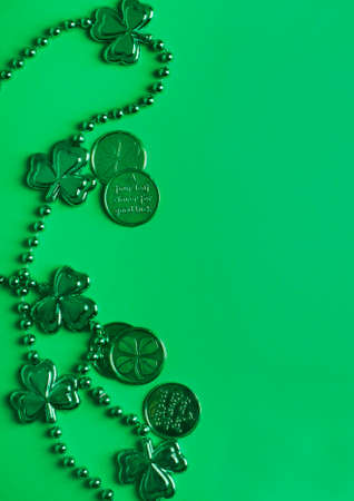 St Patricks Day green background with copy space. St Patricks Day frame of shamrocks and green coins.