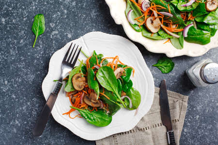Spinach salad with sherried mushrooms and carrots, top view
