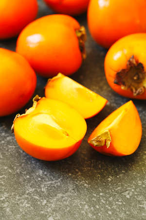 Delicious fresh persimmon fruits, copy space Stock Photo - 133836278