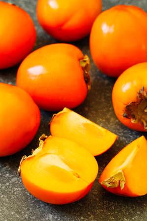 Delicious fresh persimmon fruits Stock Photo - 133836291