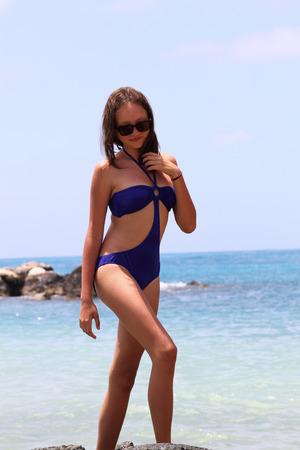 goes: beautiful girl goes the beach
