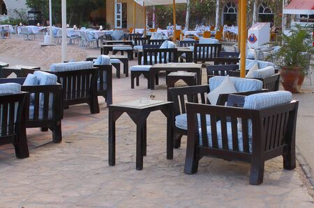 arranging chairs: outdoor restaurant, Stock Photo