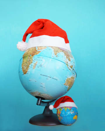 clause: Santa Clause hat on a globe