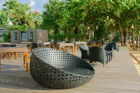armchairs: wicker furniture armchairs and a table outdoors Stock Photo