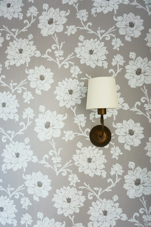 sconce: Lamp on the wall with wallpaper, sconce, bracket Stock Photo