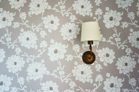 bracket: Lamp on the wall with wallpaper, sconce, bracket Stock Photo