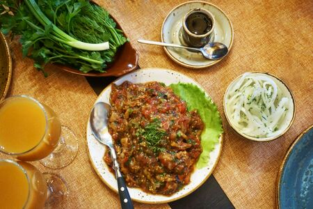 eating utensil: Salad and dishes on the table in the restaurant