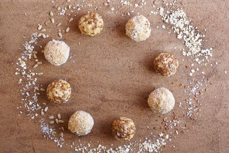 energy ball of oatmeal, coconut, flaxseeds, fruit, copy space,  top view, flat lay, image horizontal orientation, no body