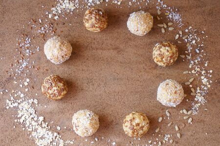 energy ball of oatmeal, coconut, flaxseeds, fruit,  top view, flat lay, image horizontal orientation, no body