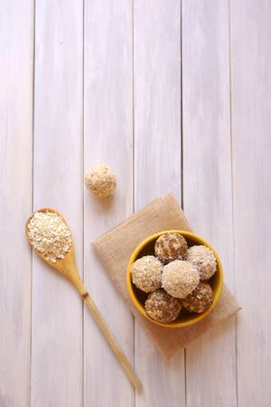 energy ball of oatmeal, coconut, flaxseeds, fruit, copy space, image horizontal orientation, no body