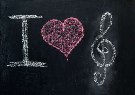 love music: i love music on blackboard with heart Stock Photo