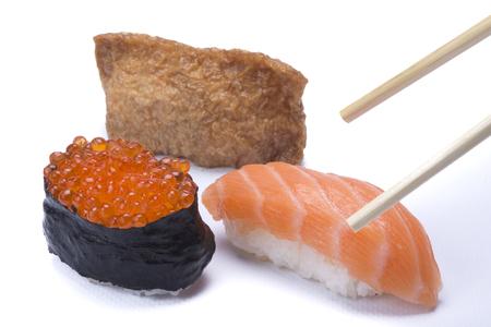 chop stick: assortment whit mixed sushi isolated on white background Stock Photo