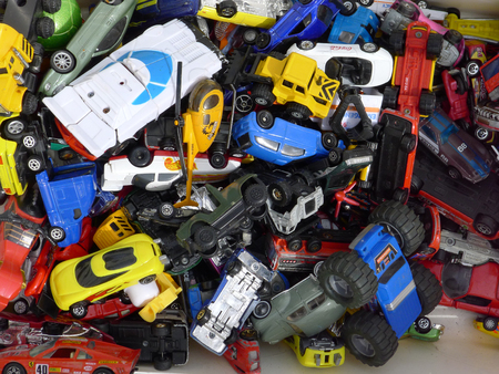 Exemplar: a bunch of car toys in many colors for sale