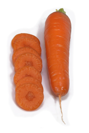 peice: carrot and cut slices isolated on white background