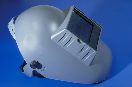 welding mask: Gray welding mask on a blue background