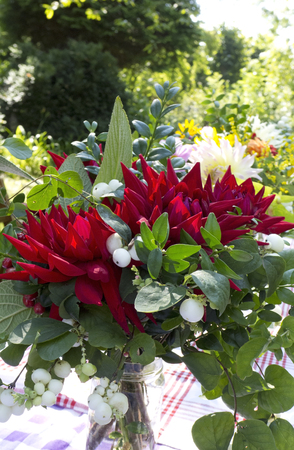 garden table: garden bouquet with Dahlias on garden table, The Netherlands