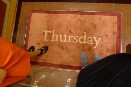 thursday: standing on door mat elevator with thursday on it