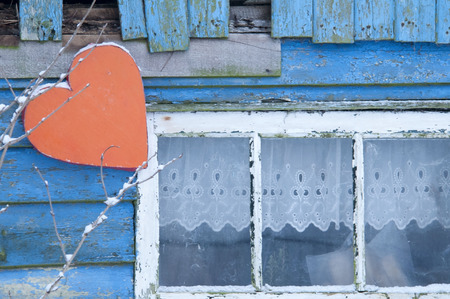 window shade: barn with red heart near window on a vintage blue shade