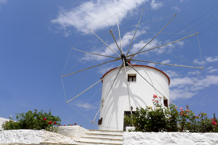 touristic: white washed mill on one of the Greek islands Kos