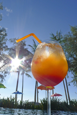 palmtrees: tequila sunrise at seaside Kho Khood Thailand with palmtrees