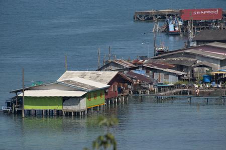 pales: corrugated iron houses on pales at fishermansvillage Kho Kood Thailand Stock Photo