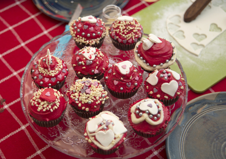 making homemade valentine cupcakes with sweet and delicious toppings