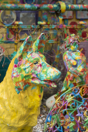 painted dog: colorful painted stone dog statue, art work Stock Photo