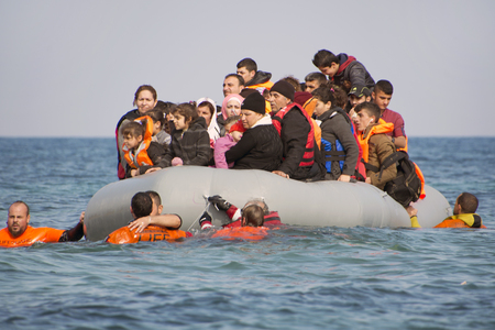 LESVOS, GREECE February 02, 2016: Refugees arriving in Greece in dinghy boat from Turkey. These Syrian, Afghanistan and African refugees land their boat near Mytilene Lesvos.