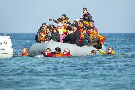 LESVOS, GREECE February 02, 2016: Refugees arriving in Greece in dinghy boat from Turkey. These Syrian, Afghanistan and African refugees land their boat near Mytilene Lesvos. Reklamní fotografie - 58004932