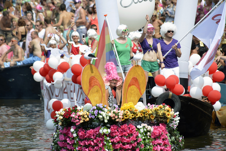 prinsengracht: Amsterdam, Netherlands - August 2, 2014: participants in the annual event for the protection of human rights and civil equality - Gay Pride Parade on the Prinsengracht, Amsterdam Editorial