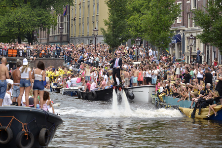 annual event: Amsterdam, Netherlands - August 2, 2014: participants in the annual event for the protection of human rights and civil equality - Gay Pride Parade on the Prinsengracht, Amsterdam Editorial