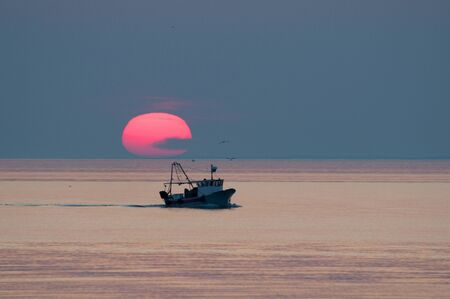 boat and sunset on the horizon above sea Stock Photo - 59742326