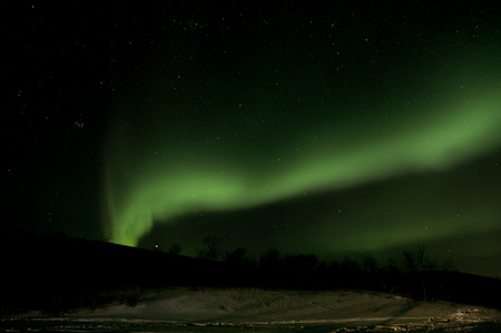 northern light: Northern green light at cold snowy mountain Norway