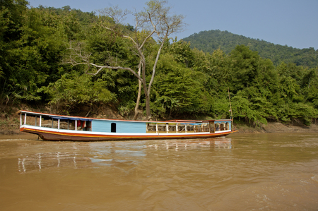 mekong river: Boat on the Mekong river in the jungle, Thailand-Laos