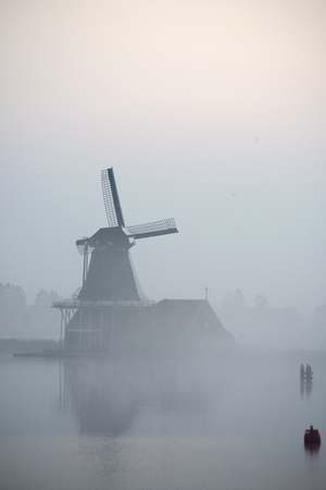 zaanse: windmills in morning fog the Netherlands, Zaanse Schans