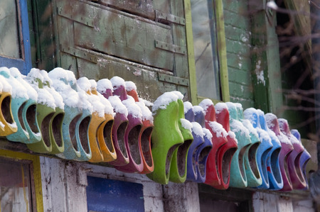 wooden shoes: colored wooden shoes om wall in the Netherlands Stock Photo