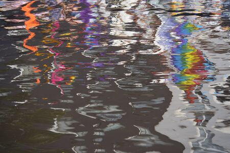 prinsengracht: Amsterdam, Netherlands - August 1, 2015: reflection on the water at the annual event for the protection of human rights and civil equality - Gay Pride Parade on the Prinsengracht, Amsterdam Stock Photo